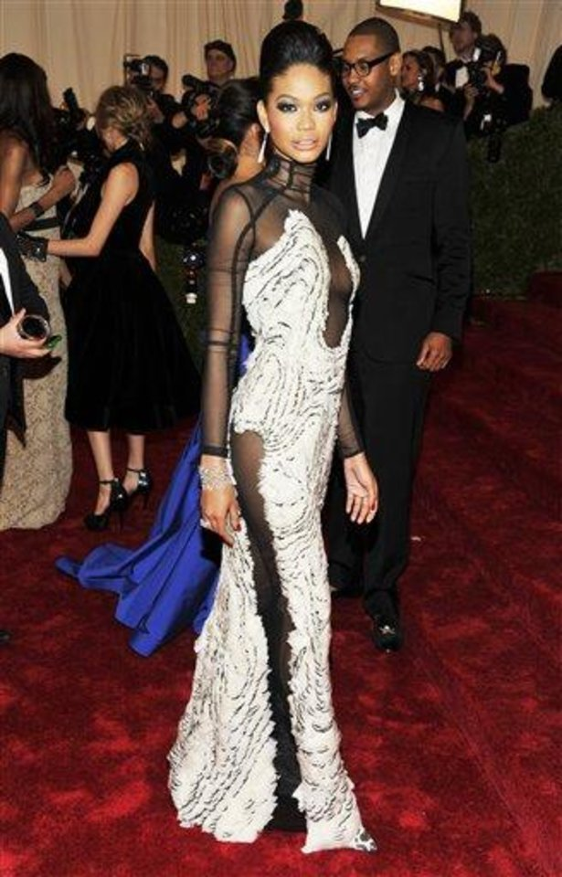 Photo - Chanel Iman arrives at the Metropolitan Museum of Art Costume Institute gala benefit, celebrating Elsa Schiaparelli and Miuccia Prada, Monday, May 7, 2012 in New York. (AP Photo/Charles Sykes)