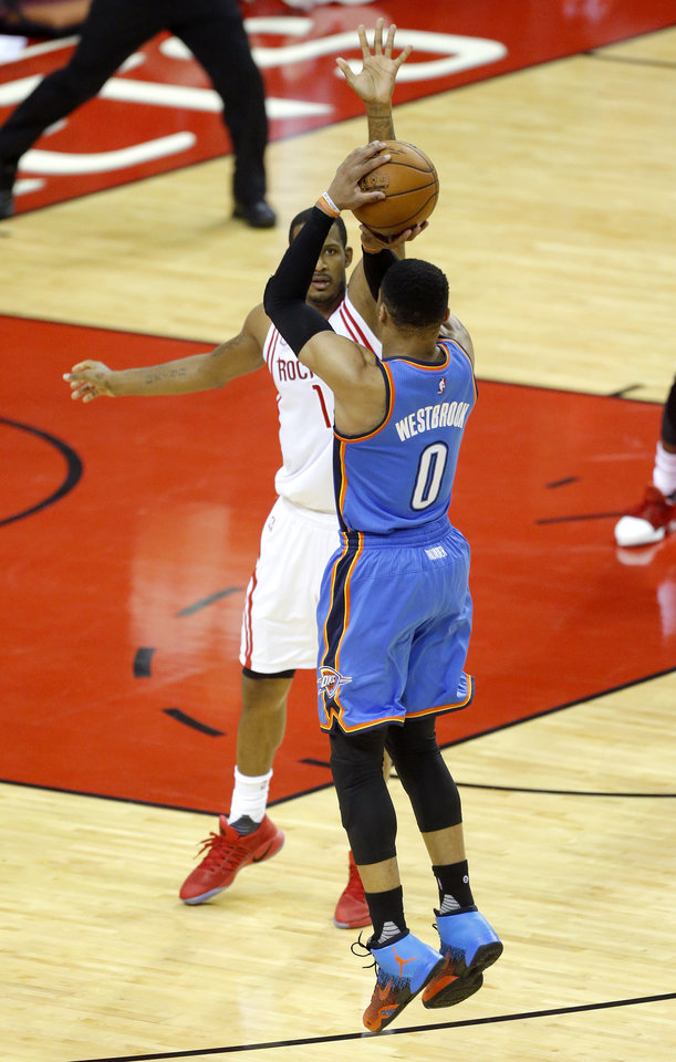Photo - Oklahoma City's Russell Westbrook (0) shoots over Houston's Trevor Ariza (1) during Game 5 in the first round of the NBA playoffs between the Oklahoma City Thunder and the Houston Rockets in Houston, Texas,  Tuesday, April 25, 2017.  Houston won 105-99. Photo by Sarah Phipps, The Oklahoman