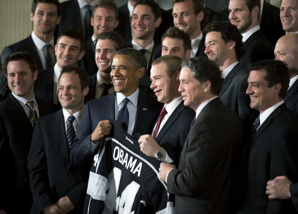 President Barack Obama, center, poses with the Los Angeles Kings as he welcomed the Stanley Cup champions and the Major League Soccer champion LA Galaxy to the White House. AP photo