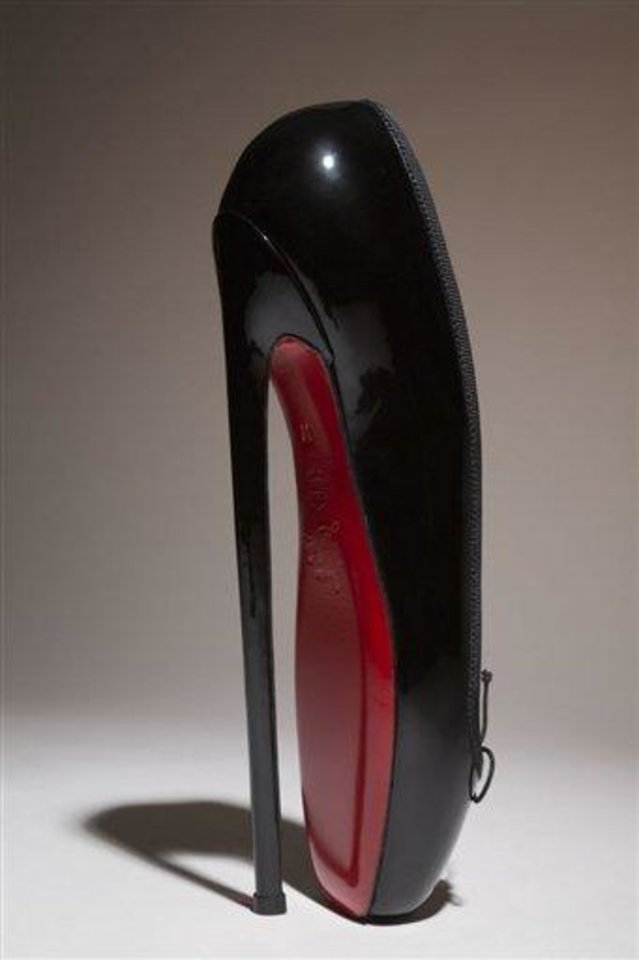 In this undated photo provided by the Fashion Institute of Technology shows Christian Louboutin\'s