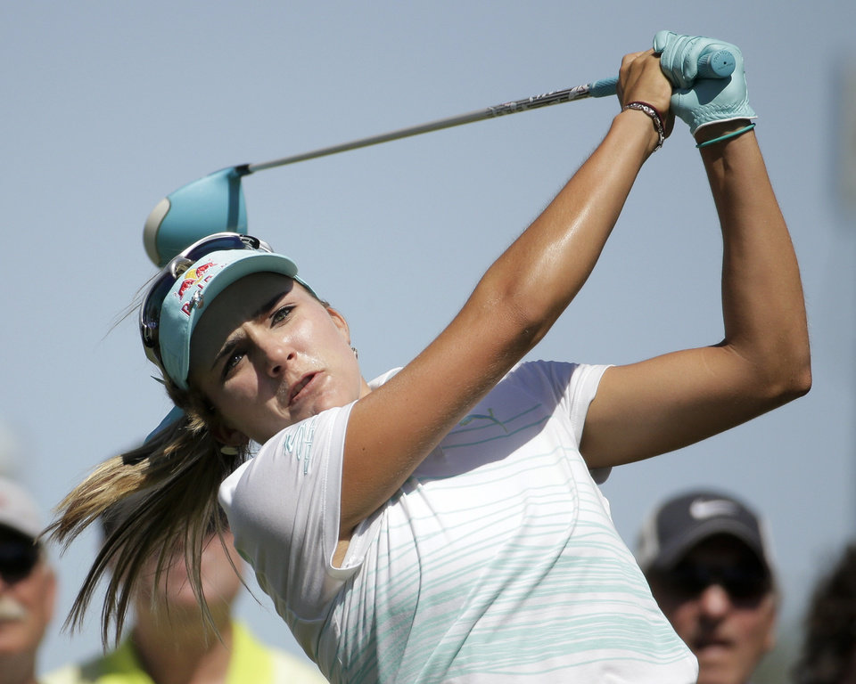 Lexi Thompson watches her tee shot on the third hole during the final round of the Kraft Nabisco Championship golf tournament Sunday, April 6, 2014, in Rancho Mirage, Calif. (AP Photo/Chris Carlson)