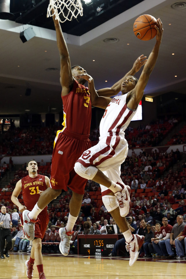 Photo - Oklahoma's Je'lon Hornbeak (5) goes up against Iowa State Cyclone's Melvin Ejim (3) as the University of Oklahoma Sooners (OU) men play the Iowa State Cyclones in NCAA, college basketball at Lloyd Noble Center on Saturday, March 2, 2013  in Norman, Okla. Photo by Steve Sisney, The Oklahoman