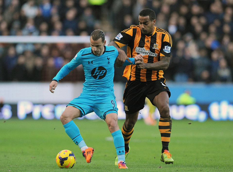 Photo - Hull City's Tom Huddlestone, right, and Tottenham Hotspur's Roberto Soldado in action during their English Premier League soccer match at the KC Stadium in Hull, England, Saturday Feb. 1, 2014. (AP Photo/Anna Gowthorpe, PA) UNITED KINGDOM OUT - NO SALES - NO ARCHIVES