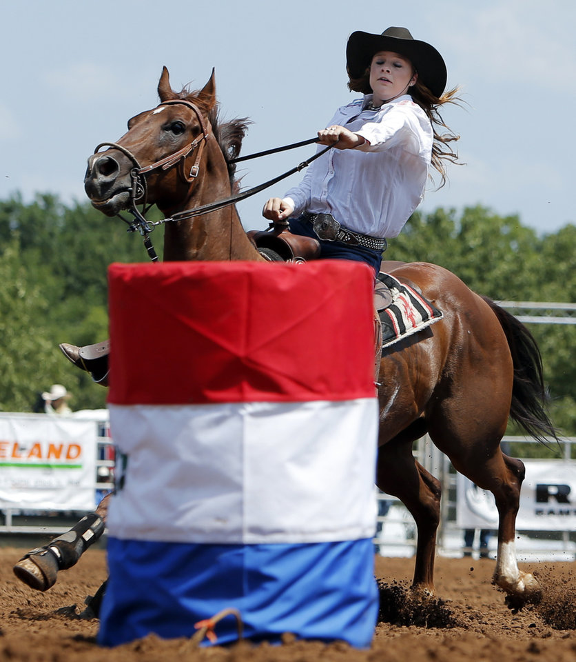 Braelyn Henry of Tucson, Ariz., makes a turn while competing in barrel racing during the International Finals Youth Rodeo at the Heart of Oklahoma Exposition Center in Shawnee, Okla., Thursday, July 12, 2012. Photo by Nate Billings, The Oklahoman