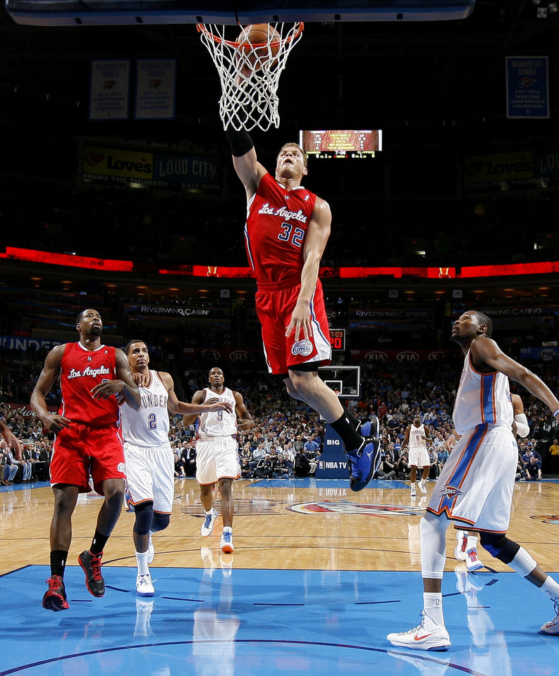 The Clippers Blake Griffin (32) dunks the ball as Oklahoma City\'s Kevin Durant (35) and Thabo Sefolosha (2) watch during an NBA basketball game between the Oklahoma City Thunder and the Los Angeles Clippers at Chesapeake Energy Arena in Oklahoma City, Wednesday, Nov. 21, 2012. Photo by Bryan Terry, The Oklahoman