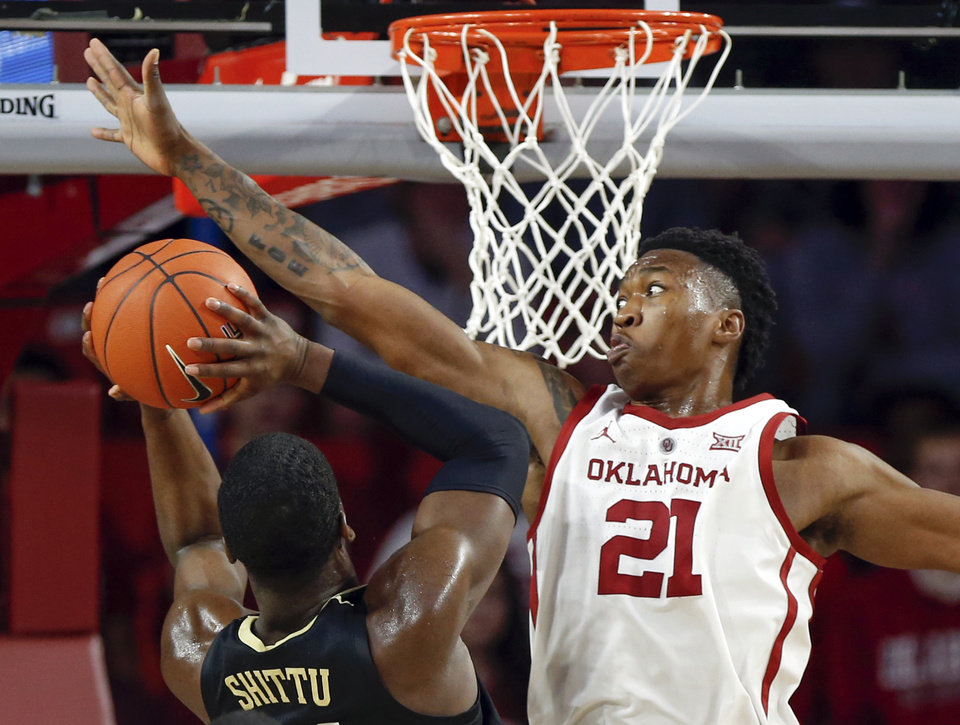 Photo - Oklahoma's Kristian Doolittle (21) defends a shot by Vanderbilt's Simisola Shittu (11) in the second half during a men's college basketball game between the Oklahoma Sooners and the Vanderbilt Commodores at Lloyd Noble Center in Norman, Okla., Saturday, Jan. 26, 2019. OU won 86-55. Photo by Nate Billings, The Oklahoman