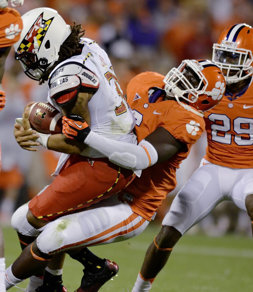 Clemson's Tavaris Barnes sacks Maryland quarterback Shawn Petty during the second half of an NCAA college football game Saturday, Nov. 10, 2012, at Memorial Stadium in Clemson, S.C. Clemson won 45-10. (AP Photo/Richard Shiro)