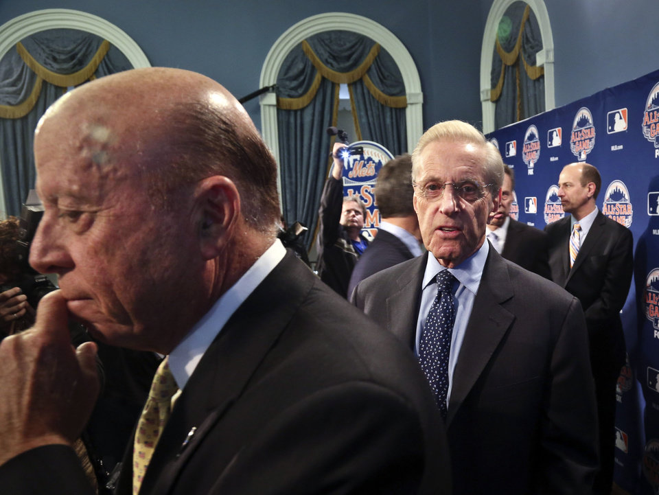 Photo - New York Mets owners Saul Katz, left, and Fred Wilpon, center, leave after a news conference to outline the festivities for baseball's All-Star game on Wednesday, April 24, 2013 in New York. The Mets are hosting the All-Star game on July 16. (AP Photo/Bebeto Matthews)