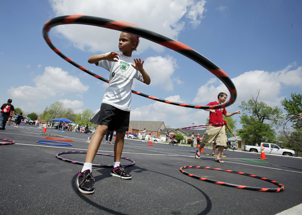 "Photo - Heavenn Fults plays with a hoop at last year's ""I Love My Neighborhood"" party in Norman. OKLAHOMAN ARCHIVES"