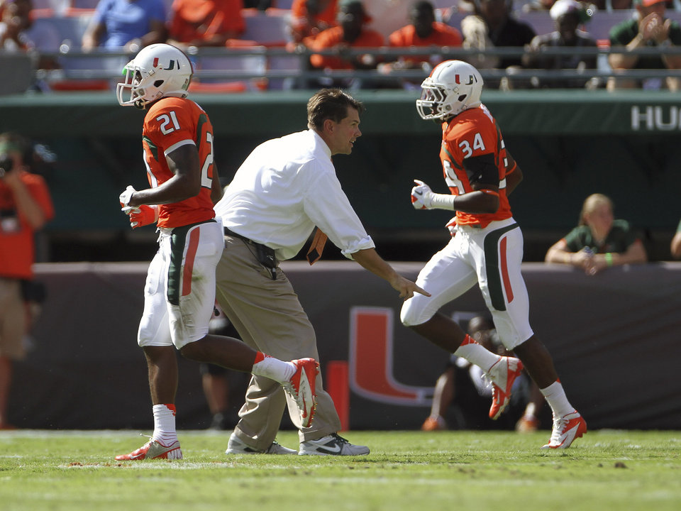 Miami's coach Al Golden yells instructions to his players during the first half of a NCAA college football game in Miami, Saturday, Oct. 13, 2012 against North Carolina. (AP Photo/J Pat Carter)