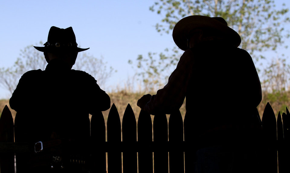 Photo - Contestants at The Land Run, cowboy action shooting competition wait to shoot at the  Oklahoma City Gun Club, Friday April 25, 2014. Photo By Steve Gooch, The Oklahoman