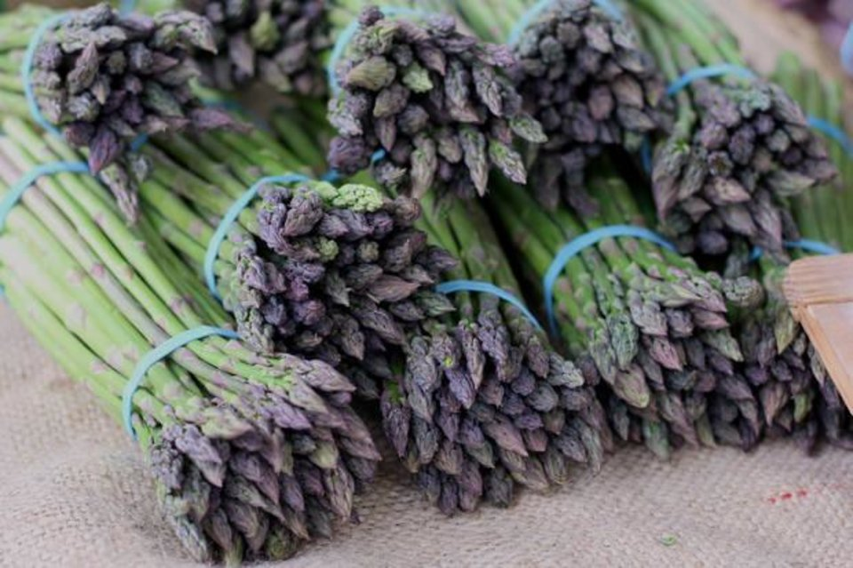 Photo -  Organic asparagus available form the Urban Agrarian is for sale during the 2016 opening weekend of the Farmers Market at Edmond's Festival Market Place. [PHOTO BY DOUG HOKE, THE OKLAHOMAN ARCHIVES]
