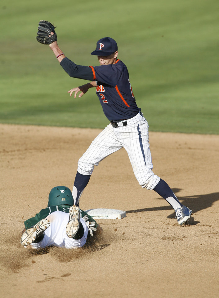 Photo - Pepperdine's Hutton Moyer (2) catches the throw from the catcher before taging out Cal Poly's Mark Mathias (12) trying to steal second base during the first inning of an NCAA college baseball tournament regional game on Sunday, June 1, 2014, at Baggett Stadium at Cal Poly in San Luis Obispo, Calif. (AP Photo/Aaron Lambert)