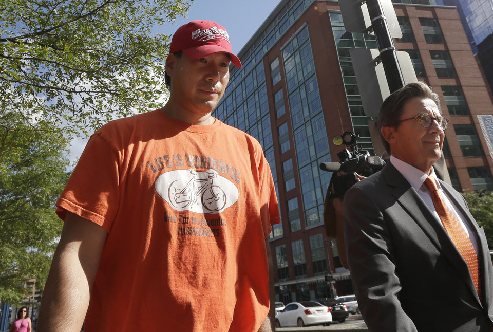 Photo - Glenn Adam Chin, left, a former supervisory pharmacist at the New England Compounding Center, walks with his attorney Paul Shaw, right, after appearing in federal court, Thursday, Sept. 4, 2014, in Boston. The pharmacy, which custom-mixed medications in bulk, has been blamed for a 2012 outbreak of fungal meningitis that killed 64 people. Chin was charged with one count of mail fraud, but federal prosecutors said it is part of a larger criminal investigation of Chin and others. (AP Photo/Steven Senne)
