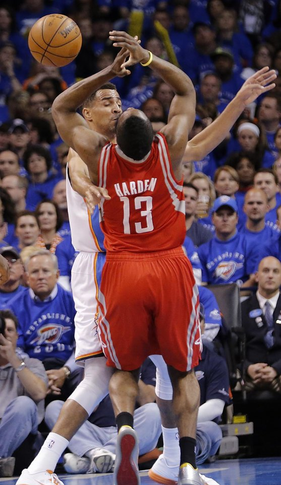 Oklahoma City\'s Thabo Sefolosha (2) and Houston\'s James Harden (13) collied during Game 2 in the first round of the NBA playoffs between the Oklahoma City Thunder and the Houston Rockets at Chesapeake Energy Arena in Oklahoma City, Wednesday, April 24, 2013. Photo by Chris Landsberger, The Oklahoman