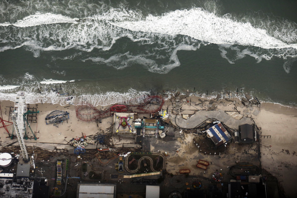 In this aerial photo, debris from an amusement park destroyed during superstorm Sandy lines the beach in Seaside Heights, N.J. The photo was taken during a flight to document coastal changes by the National Oceanic and Atmospheric Administration, after Superstorm Sandy, Thursday, Nov. 1, 2012. (AP Photo/Alex Brandon) ORG XMIT: XIF101