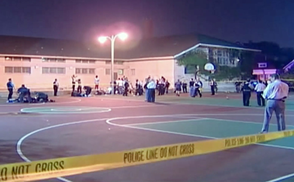 Photo - This still frame made from Thursday, Sept. 19, 2013, video provided by Ken Herzlich, shows the scene where a number of people, including a 3-year-old child, were shot Thursday night in a city park in Chicago. Thursday night's attack was the latest violence in a city that has struggled to stop such shootings by increasing police patrols. (AP Photo/Courtesy Ken Herzlich)