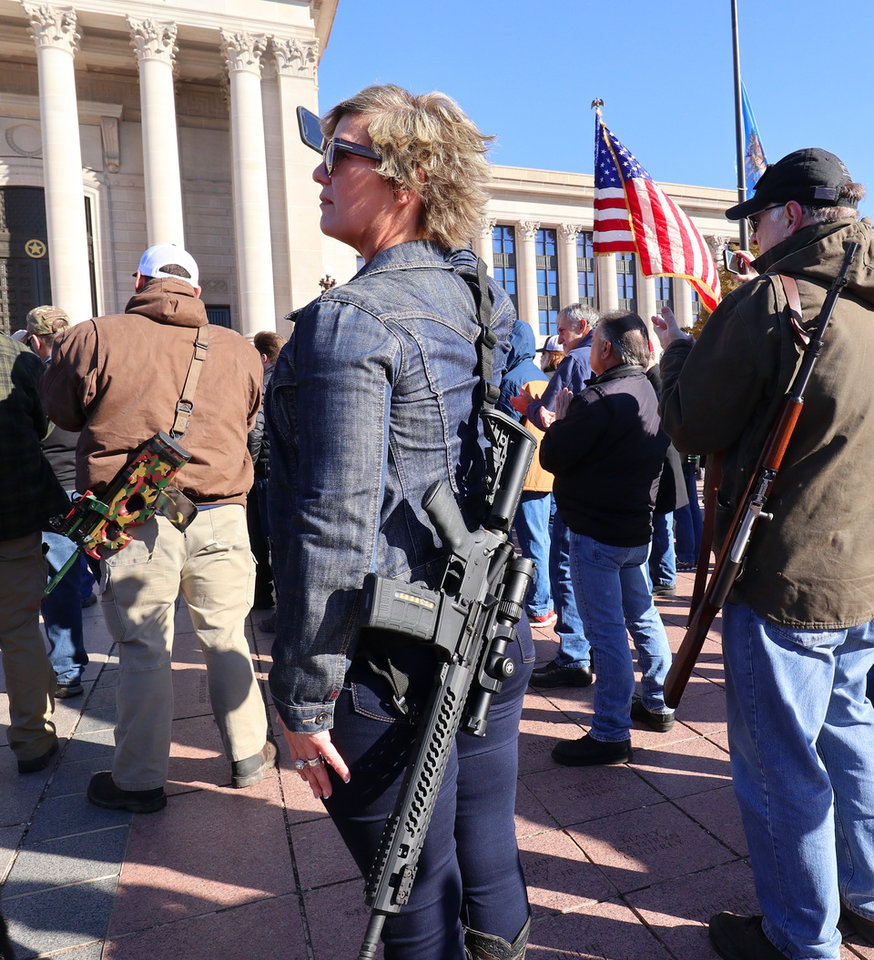 Photo - Leslie Nessmith, Edmond, videos the rally on her phone. Second Amendment supporters rally at the state Capitol to celebrate the permitless carry law taking effect. Friday, November 1, 2019. [Doug Hoke/The Oklahoman]