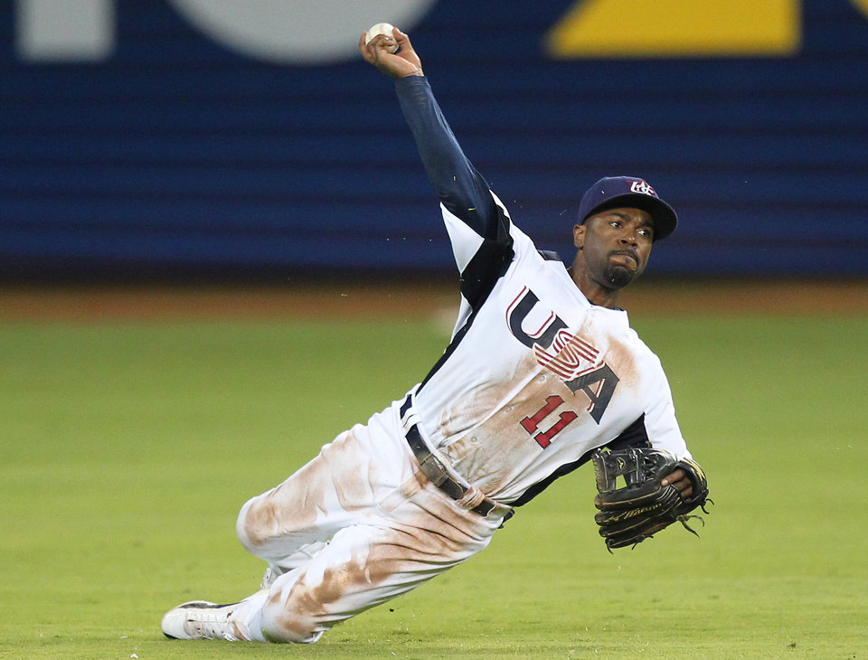USA shortstop Jimmy Rollins throws from the ground during the ninth inning of the World Baseball Classic second round Pool 2 elimination game between Puerto Rico and the United States at Marlins Park in Miami on Friday, March 15, 2013. Puerto Rico defeated the U.S. 4-3. (AP Photo/The Miami Herald, David Santiago)  MAGS OUT