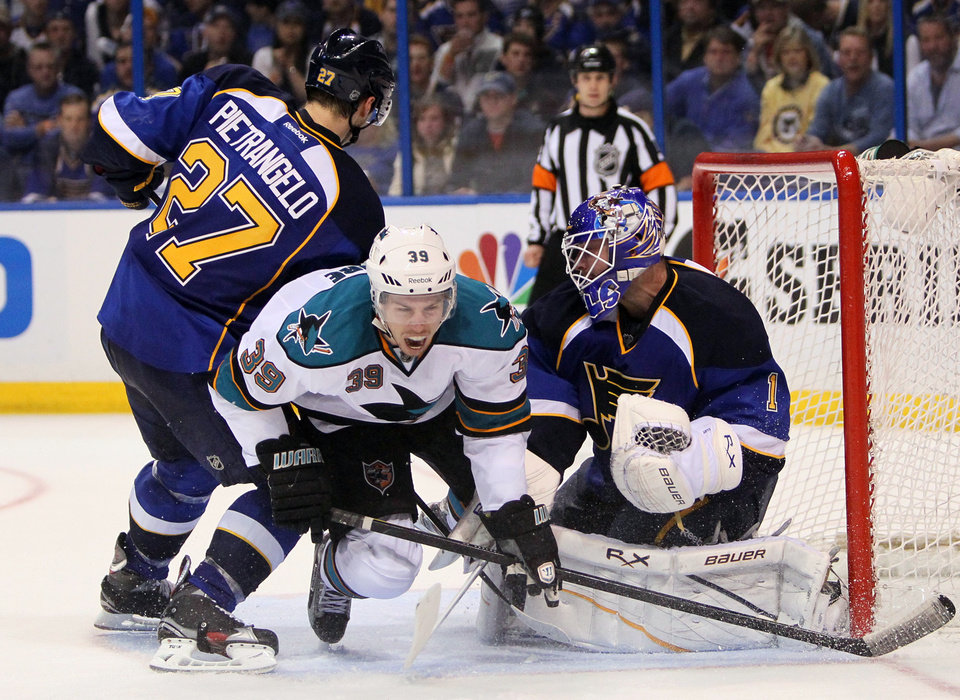 Photo -   San Jose center Logan Couture (39) is sandwiched between Blues goaltenderAlex Pietrangelo (27) and goaltender Brian Elliott during the second period in Game 2 of an NHL Stanley Cup first-round hockey playoff series Saturday, April 14, 2012, in St. Louis. The Blues won 3-0. (AP Photo/The St. Louis Post-Dispatch, Chris Lee) EDWARDSVILLE INTELLIGENCER OUT; THE ALTON TELEGRAPH OUT