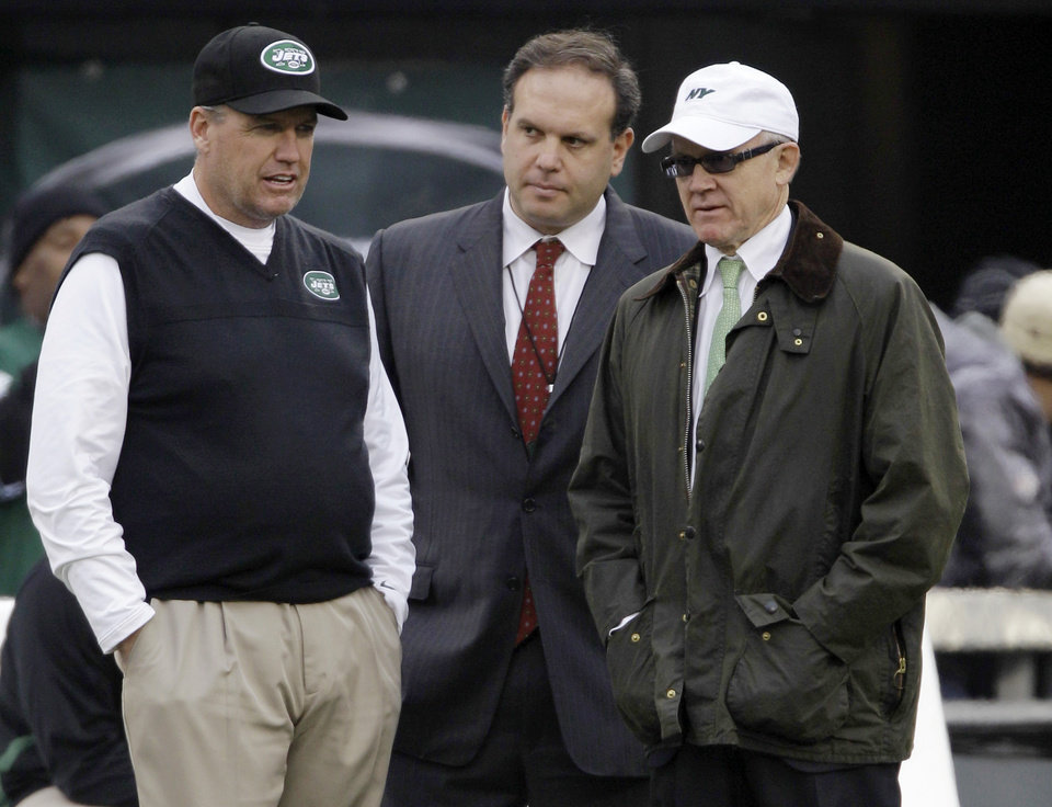 "FILE - In this Dec. 2, 2012, file photo, New York Jets head coach Rex Ryan, left, stands with general manager Mike Tannenbaum, center, and owner Woody Johnson before an NFL football game against the Arizona Cardinals in East Rutherford, N.J. Ryan insists he's a Jet all the way and wants to coach the team for the ""next 15 years."" He dismisses as ""untrue"" a report that says he would welcome being fired if Johnson doesn't upgrade the offense. (AP Photo/Kathy Willens, File)"