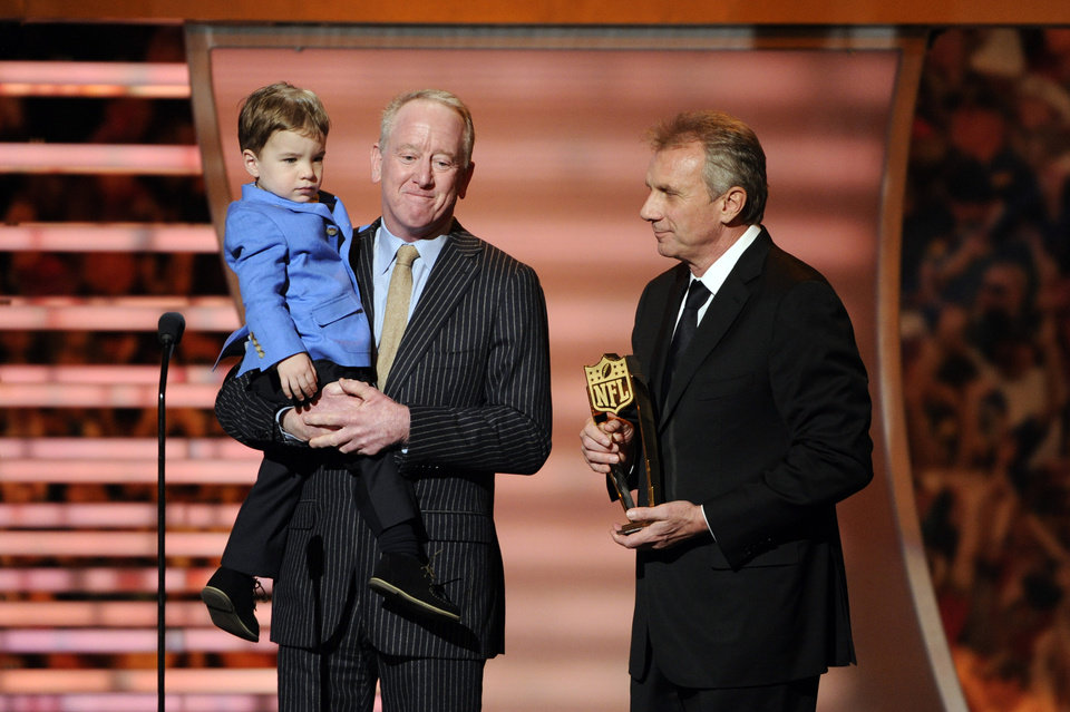 Photo - Former NFL quartetrback Joe Montana, right, presents the award for AP Most Valuable Player to Archie Manning and Marshall Manning, on behalf of Denver Broncos quarterback Peyton Manning, son of Archie Manning, at the third annual NFL Honors at Radio City Music Hall on Saturday, Feb. 1, 2014, in New York. (Photo by Evan Agostini/Invision for NFL/AP Images)