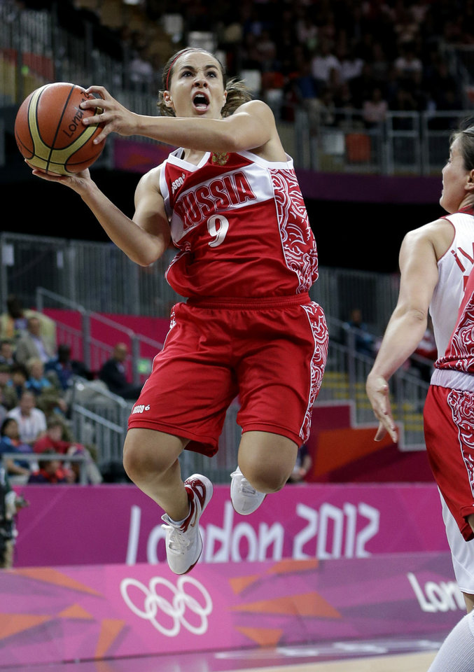 Photo - Russia's Becky Hammon shoots against Turkey during a quarterfinal women's basketball game at the 2012 Summer Olympics, Tuesday, Aug. 7, 2012, in London. (AP Photo/Eric Gay)