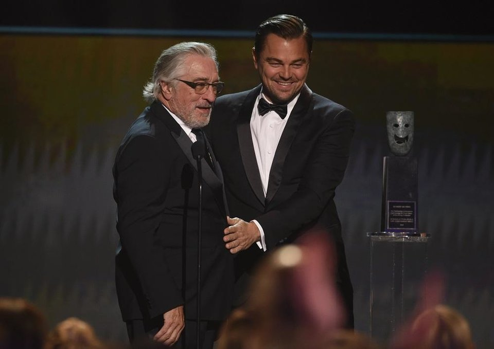 Photo - Leonardo DiCaprio, right, presents the lifetime achievement award to Robert De Niro at the 26th annual Screen Actors Guild Awards at the Shrine Auditorium & Expo Hall on Sunday, Jan. 19, 2020, in Los Angeles. [AP Photo/Chris Pizzello]