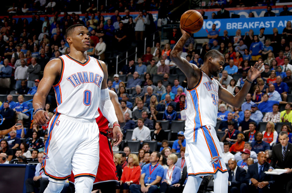 Photo - Oklahoma City's Kevin Durant (35) grabs the ball beside Russell Westbrook (0) after a Toronto basket during an NBA basketball game between the Oklahoma City Thunder and the Toronto Raptors at Chesapeake Energy Arena on Wednesday, Nov. 4, 2015. The Thunder lost 103-98. Photo by Bryan Terry, The Oklahoman