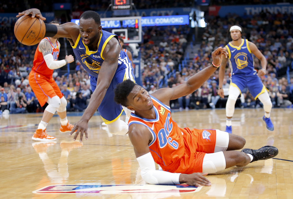 Photo - Golden State's Draymond Green (23) gets a loose ball from Oklahoma City's Hamidou Diallo (6) during the NBA game between the Oklahoma City Thunder and Golden State Warriors at Chesapeake Energy Arena,  Sunday, Oct. 27, 2019. Thunder won 120-92.[Sarah Phipps/The Oklahoman]