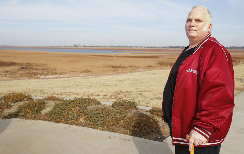 Ed Roberts stands  Friday at Lake Hefner in Oklahoma City. He got stuck in a hidden mud hole in 2011 at the lake. Photo By  Steve Gooch,  The Oklahoman
