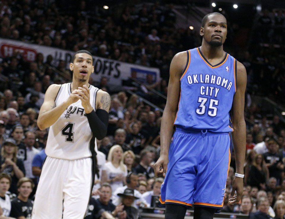 Photo - Oklahoma City's Kevin Durant (35) reacts to a technical call in front of San Antonio's Danny Green (4) during Game 1 of the Western Conference Finals in the NBA playoffs between the Oklahoma City Thunder and the San Antonio Spurs at the AT&T Center in San Antonio, Monday, May 19, 2014. Photo by Sarah Phipps, The Oklahoman