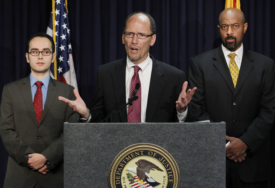 Photo -   United States Assistant Attorney General Thomas Perez, middle, who heads up the civil rights division at the Department of Justice, is joined by Deputy Assistant Attorney General for Civil Rights, Roy Austin, right, and Sergio Perez, attorney for the Civil Right Division at the Department of Justice, as Perez announces a federal civil lawsuit against Maricopa County Sheriff Joe Arpaio, his office, and the county, at a news conference Thursday, May 10, 2012, in Phoenix. After months of negotiations failed to yield an agreement to settle allegations that his department racially profiled Latinos in his trademark immigration patrols. (AP Photo/Ross D. Franklin)