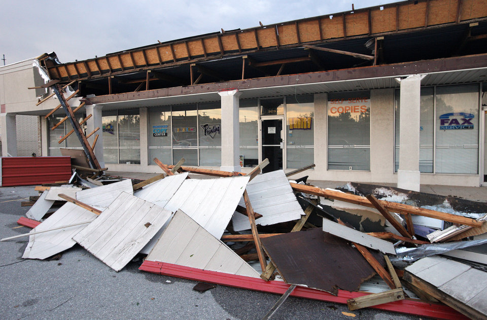 Photo - Storm damage to building at  3625 and 3629 NW 50 Street in Oklahoma City Tuesday, August 7, 2012. Photo by Paul B. Southerland, The Oklahoman