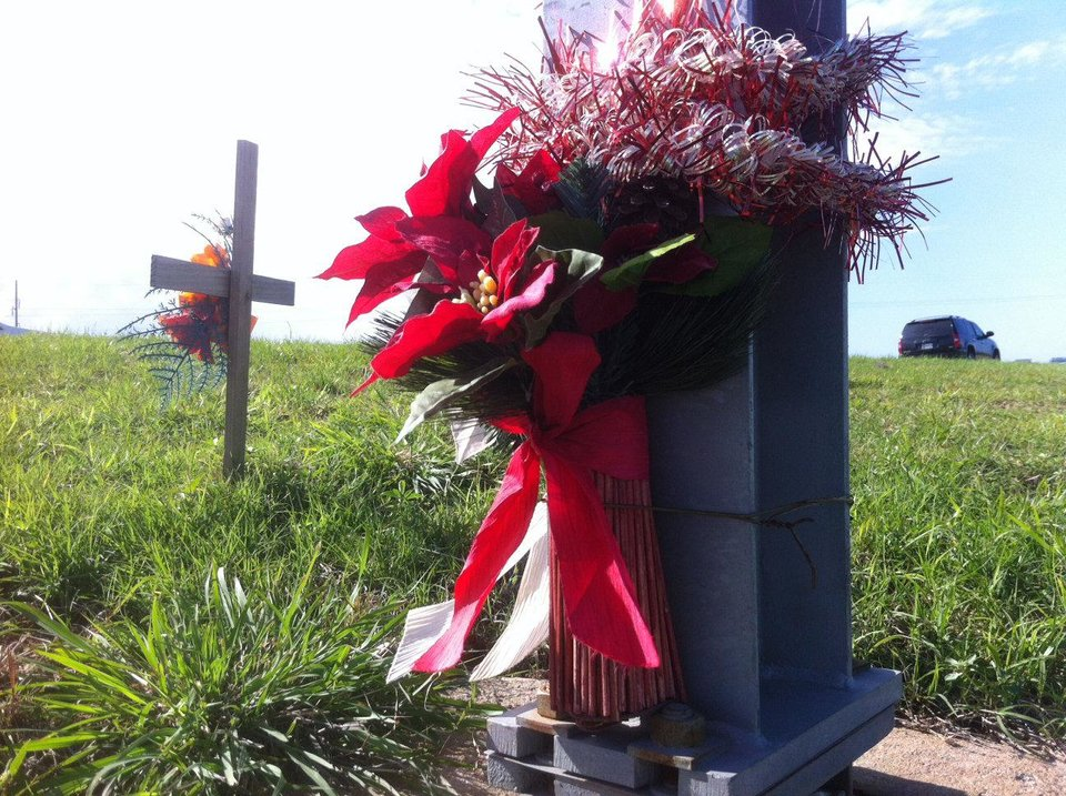 Photo - A roadside memorial can be seen on Lake Hefner Parkway in Oklahoma south of Britton Road. Such markers are common at locations where people have lost loved ones.  The Okalhoman - ROBERT MEDLEY