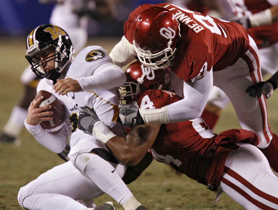 Photo - Oklahoma's Cory Bennett (97) and Frank Alexander (84) sack Missouri's Chase Daniel (10) during the first half of the Big 12 Championship college football game between the University of Oklahoma Sooners (OU) and the University of Missouri Tigers (MU) on Saturday, Dec. 6, 2008, at Arrowhead Stadium in Kansas City, Mo. 