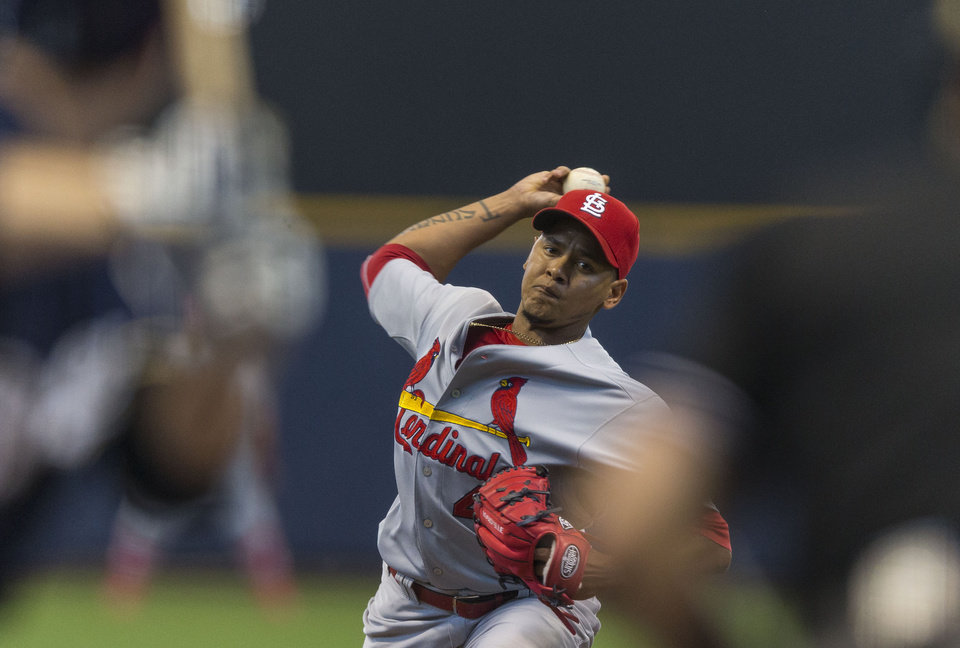 Photo - St. Louis Cardinals' Carlos Martinez pitches to a Milwaukee Brewers'  batter during the first  inning of a baseball game Sunday, July 13, 2014, in Milwaukee. (AP Photo/Tom Lynn)