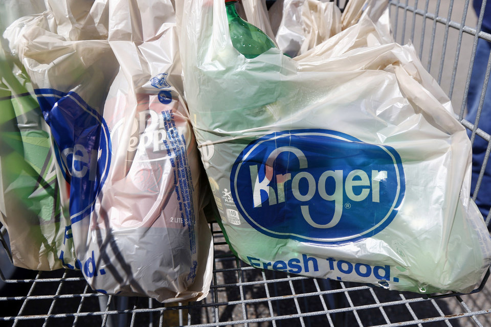Photo -  Bagged purchases from the Kroger grocery store in Flowood, Miss., sit inside this shopping cart, June 15, 2017. [Rogelio V. Solis/Associated Press file photo]