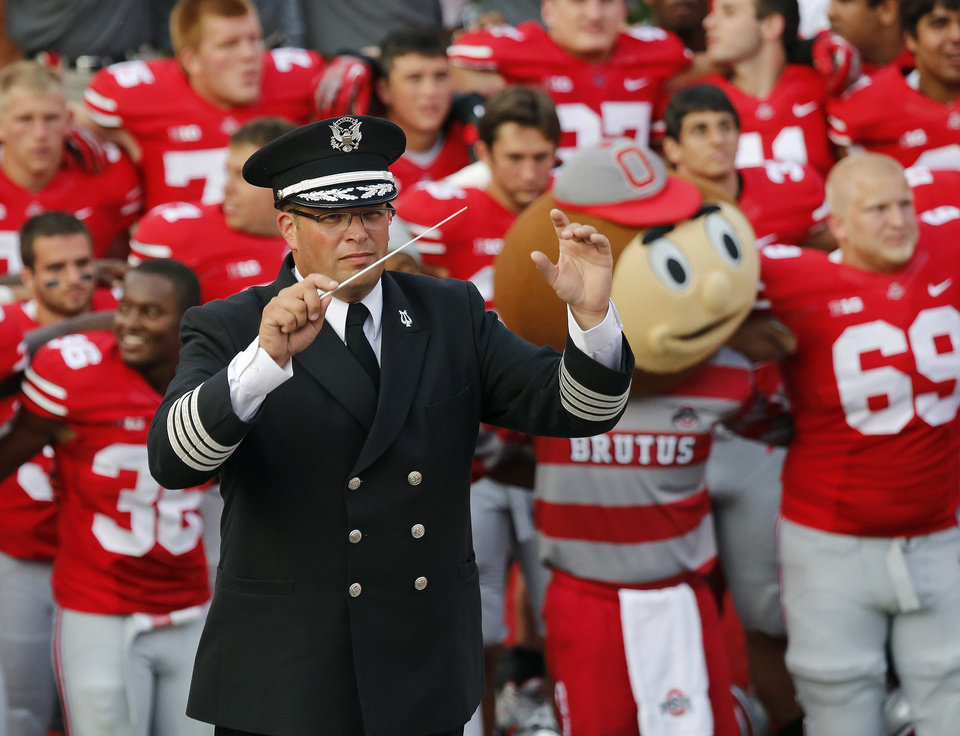 Photo - FILE - In this Sept. 7, 2013 file photo, Ohio State University marching band director Jon Waters leads the band in