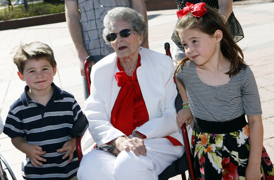 Photo -  Beckett Barnwell, left, and Baylee Barnwell sit with their great-grandmother, 99-year-old Gladie Barnwell, at a ceremony to dedicate a paver bearing her name at the state Capitol. Photo by K.T. King, The Oklahoman   KT King -