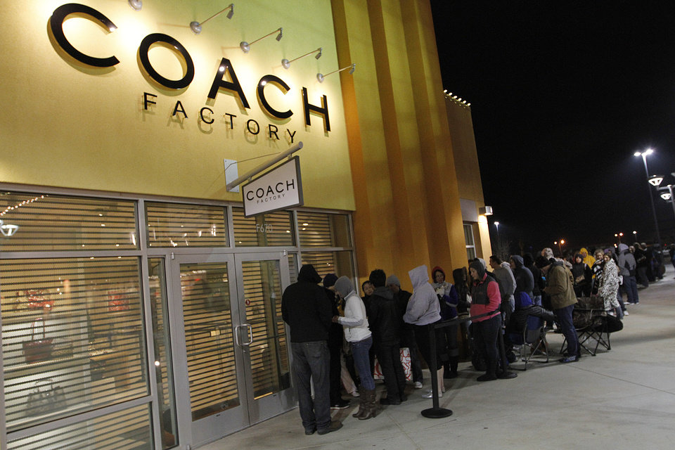 Photo - Customers wait outside of the Coach outlet during Black Friday at The Outlet Shoppes at Oklahoma City, Thursday, Nov. 24, 2011.  Photo by Garett Fisbeck, For The Oklahoman