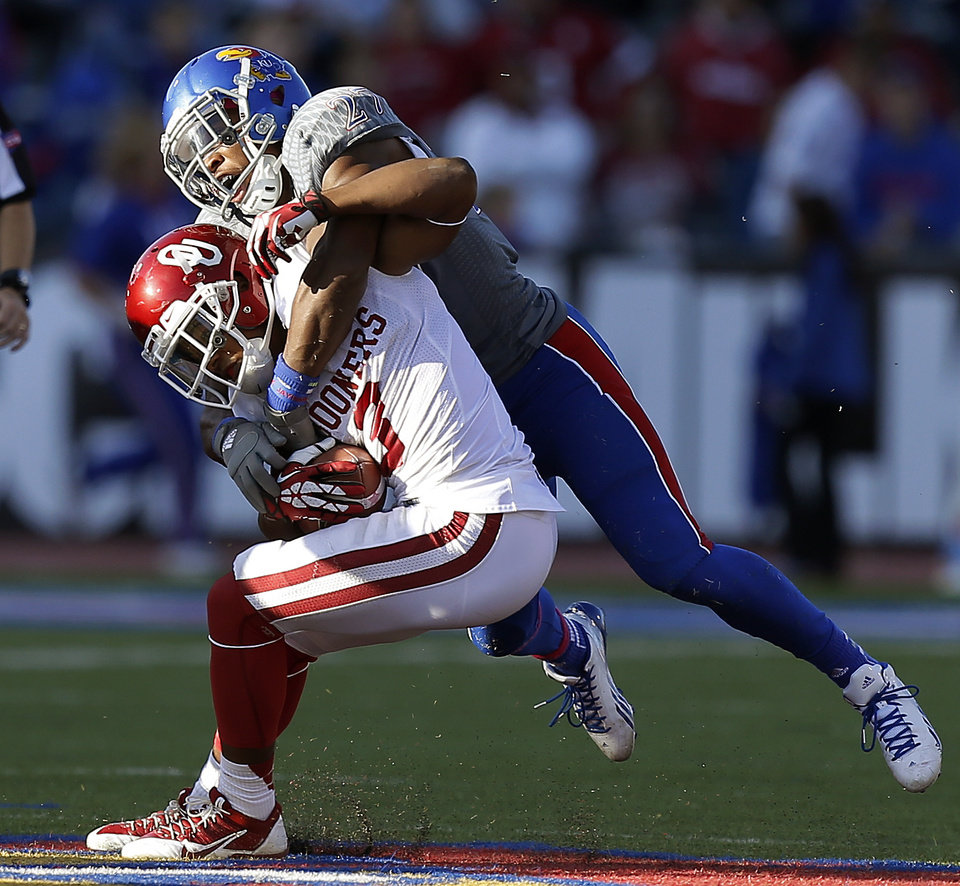 OU's Sterling Shepard (3) tries to get away from KU's Victor Simmons (27) during the college football game between the University of Oklahoma Sooners (OU) and the University of Kansas Jayhawks (KU) at Memorial Stadium in Lawrence, Kan., Saturday, Oct. 19, 2013. Oklahoma won 34-19. Photo by Bryan Terry, The Oklahoman