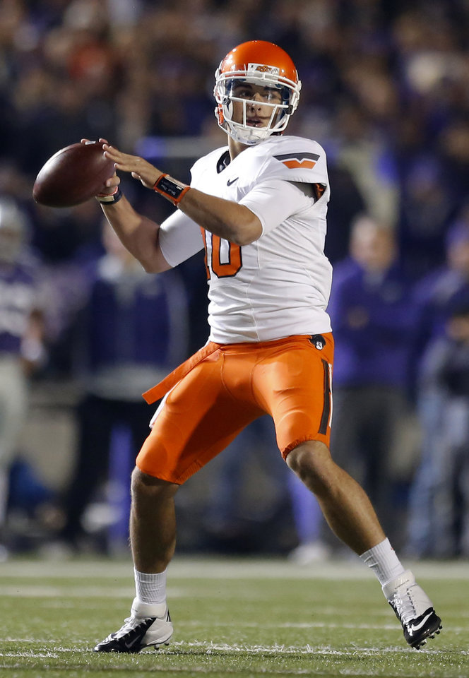 Photo - Oklahoma State's Clint Chelf (10) throws the ball during the college football game between Kansas State University (KSU) and Oklahoma State (OSU) at  Bill Snyder Family Football Stadium in Manhattan, Kan.,  Saturday, Nov. 3, 2012. Photo by Sarah Phipps, The Oklahoman