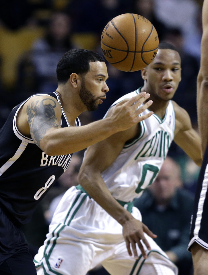 Photo - Brooklyn Nets point guard Deron Williams (8) controls the ball as Boston Celtics guard Avery Bradley (0) defends during the first quarter of an NBA basketball game in Boston, Wednesday, April 10, 2013. (AP Photo/Elise Amendola)