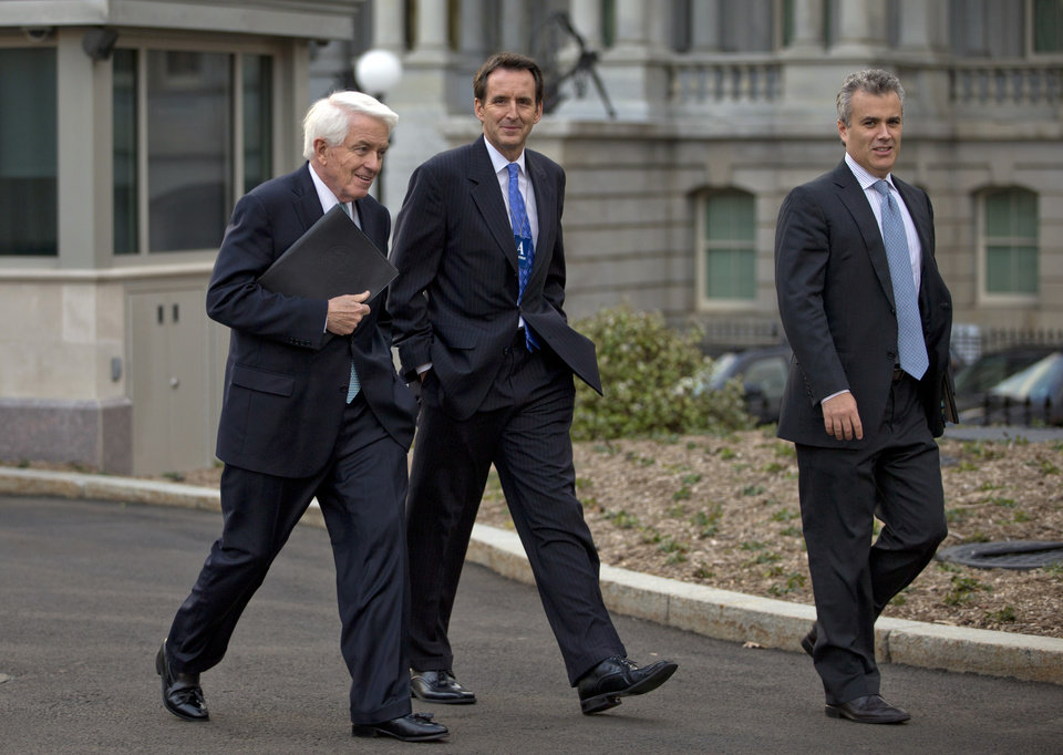 Photo - From left,  U.S. Chamber of Commerce Chief Executive Tom Donohue, former Minnesota Gov. and GOP presidential candidate Tim Pawlenty, and, Jeffrey Zients of the Office of Management and Budget, walk from the White House after a meeting with White House staff regarding the fiscal cliff, Wednesday, Dec. 19, 2012, in Washington. (AP Photo/Carolyn Kaster)