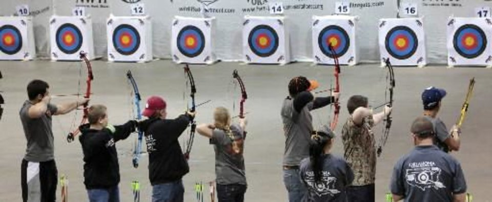 Students line up to shoot in last year's Archery in the Schools state tournament. Photo By David McDaniel, The Oklahoman Archives     <strong> -  By David McDaniel, The Oklahoman </strong>
