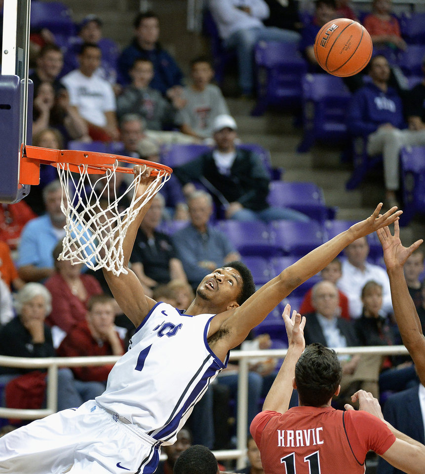 Photo - TCU center Karviar Shepherd (1) is unable to sink a dunk and is also called for a technical foul for hanging on to the rim during the first half against Texas Tech during an NCAA college basketball game Saturday, Jan. 18, 2014, in Fort Worth, Texas. Texas Tech won 60-49. (AP Photo/Fort Worth Star-Telegram, Max Faulkner) MAGS OUT (FORT WORTH WEEKLY, 360 WEST); INTERNET OUT