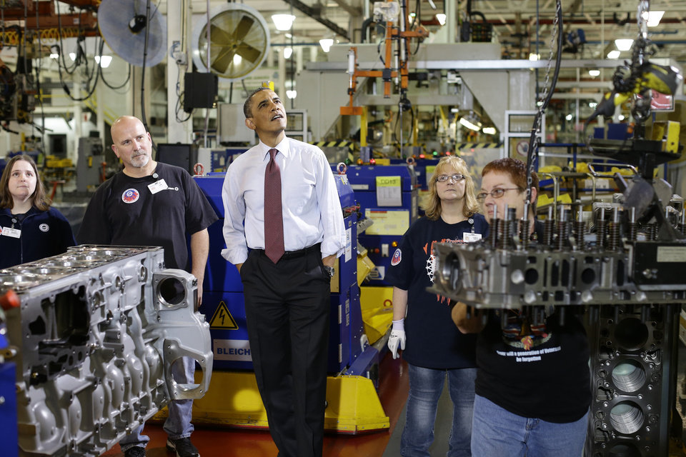 Photo - President Barack Obama watches workers during a visit to the heavy duty engines line at the Daimler Detroit Diesel plant in Redford, Mich., Monday, Dec. 10, 2012. (AP Photo/Charles Dharapak)