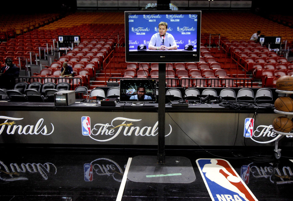 Photo - Oklahoma CIty coach Scott Brooks is seen on a monitor before practice for Game 3 of the NBA Finals between the Oklahoma City Thunder and the Miami Heat at American Airlines Arena in Miami, Saturday, June 16, 2012. Photo by Bryan Terry, The Oklahoman