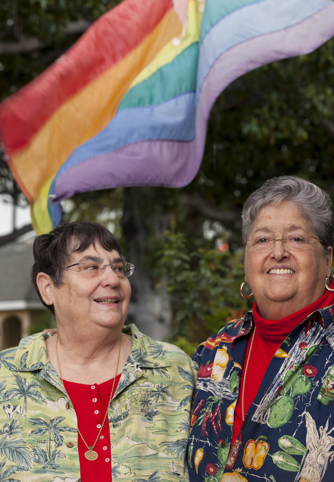 Photo - In this Friday, March 8, 2013 photo, married couple Sharon Raphael, left, and Mina Meyer pose for a photo at their home in Long Beach, Calif. Accountants and attorneys are encouraging married same-sex couples to apply now for retroactive tax refunds and Social Security benefits in anticipation of the Supreme Court possibly overturning a federal law that prevents the federal government from recognizing gay and lesbian unions. (AP Photo/Damian Dovarganes)